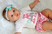 Здоровый взгляд на выбор одежды для новорожденного
